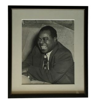 Photograph Inscribed by Armstrong. Louis Armstrong.